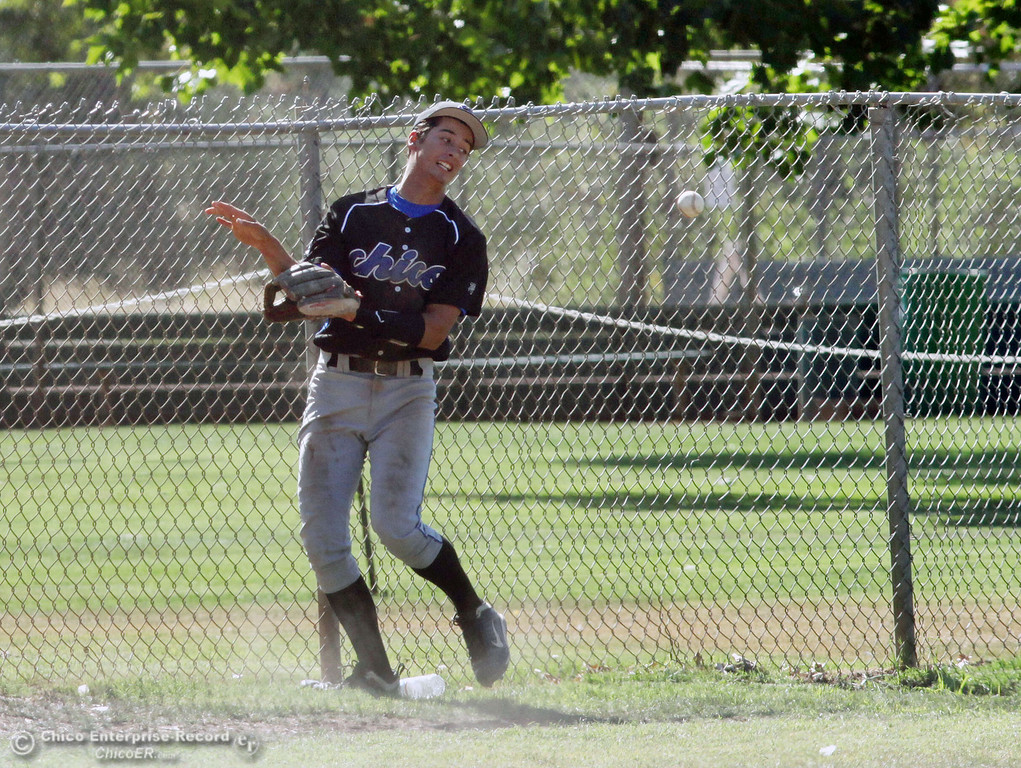 . Chico Nuts\' #12 Michael Sanderson hits the fence going for a foul ball against Redding Tigers in the bottom of the fourth inning during their American Legion baseball game at Doryland field Friday, July 19, 2013 in Chico, Calif.  (Jason Halley/Chico Enterprise-Record)