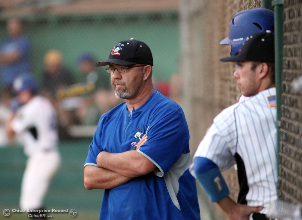 . Chico Nuts\' head coach Tom Stevens looks on against Yolo Post 77 in the bottom of the fourth inning during their American Legion baseball game at Doryland Field Thursday, July 18, 2013 in Chico, Calif.  (Jason Halley/Chico Enterprise-Record)