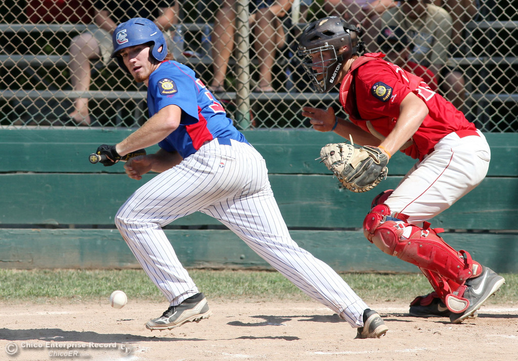 . Chico Nuts\' #33 Andrew Shippelhoute attempts to lay down a bunt against Yolo Post 77 in the bottom of the second inning during their American Legion baseball game at Doryland field Saturday, July 20, 2013 in Chico, Calif.  (Jason Halley/Chico Enterprise-Record)