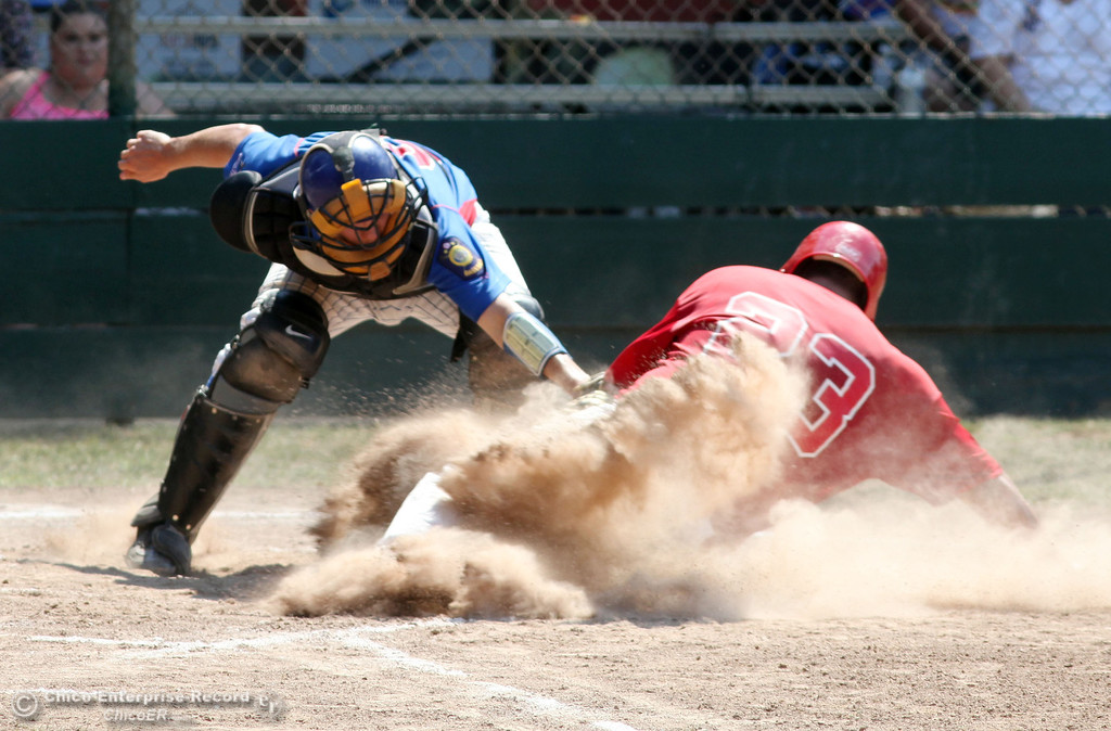 . Chico Nuts\' #9 Zach Visinoni (left) places the tag at home plate against Yolo Post 77\'s #23 Nicolas Sandoval (right) in the top of the second inning during their American Legion baseball game at Doryland field Saturday, July 20, 2013 in Chico, Calif. Sandoval was originally called safe by home plate umpire, but later reversed the call after talking to outfield umpire. The run did not count. (Jason Halley/Chico Enterprise-Record)