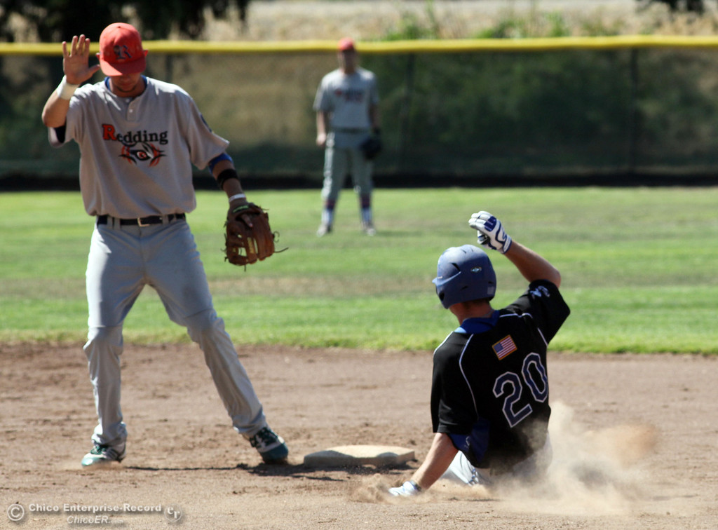 . Chico Nuts\' #20 Jackson Murphy (right) slides in safely to second base against Redding Tigers\' #23 Austin LaBue (left) in the top of the second inning during their American Legion baseball game at Doryland field Friday, July 19, 2013 in Chico, Calif.  (Jason Halley/Chico Enterprise-Record)
