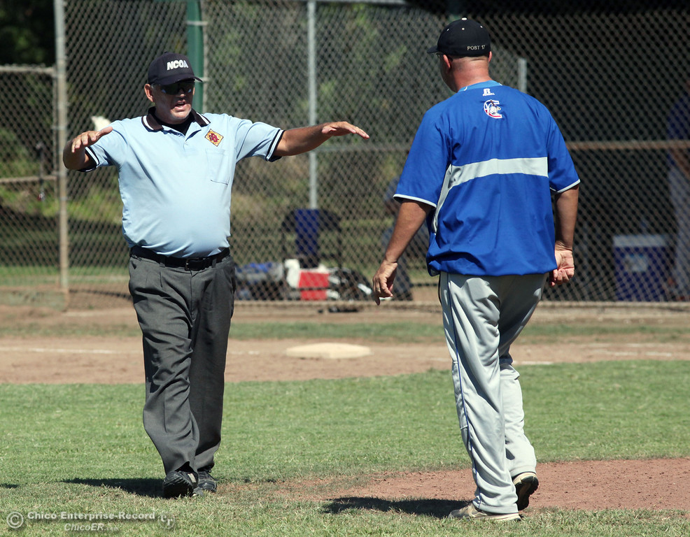 . Chico Nuts head coach Tom Stevens argues a call against the umpire against Redding Tigers in the top of the third inning during their American Legion baseball game at Doryland field Friday, July 19, 2013 in Chico, Calif.  (Jason Halley/Chico Enterprise-Record)