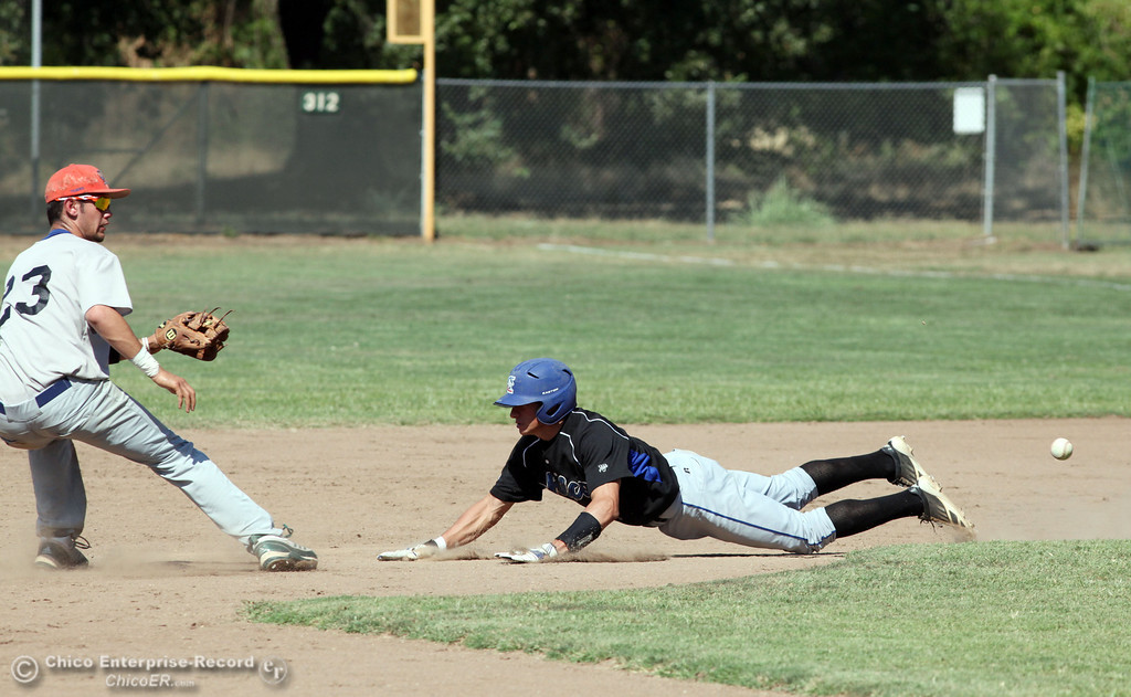 . Chico Nuts\' #7 Ryan Souza (right) slides in late to second base against Redding Tigers\' #23 Austin LaBue (left) in the top of the third inning during their American Legion baseball game at Doryland field Friday, July 19, 2013 in Chico, Calif.  (Jason Halley/Chico Enterprise-Record)