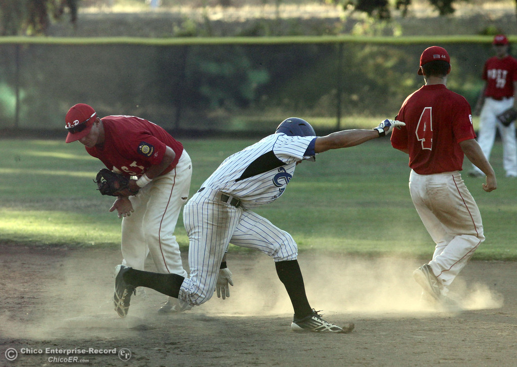 . Chico Nuts\' #7 Ryan Souza (center) jumps back safely to second base in a pick off attempt against Yolo Post 77\'s #5 Michael Chavarria (left) and #4 Joseph Murray (right) in the bottom of the first inning during their American Legion baseball game at Doryland Field Thursday, July 18, 2013 in Chico, Calif.  (Jason Halley/Chico Enterprise-Record)