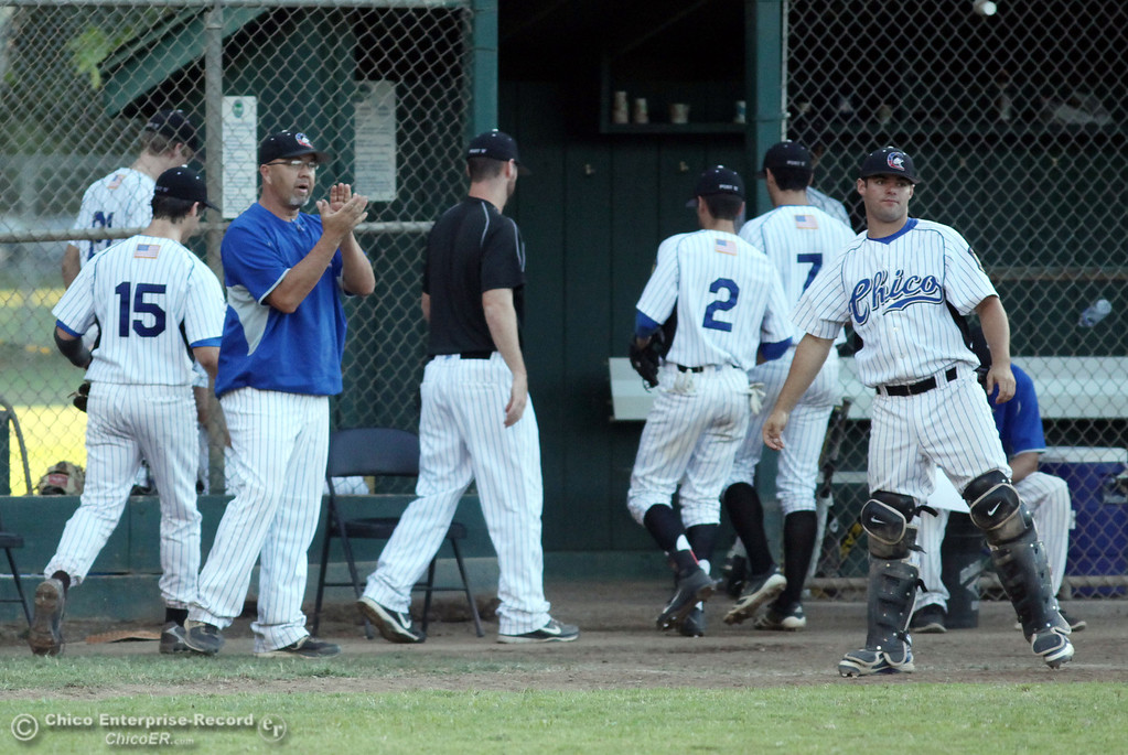 . Chico Nuts\' head coach Tom Stevens (center) congratulates the team ending the top of the third inning against Yolo Post 77 during their American Legion baseball game at Doryland Field Thursday, July 18, 2013 in Chico, Calif.  (Jason Halley/Chico Enterprise-Record)