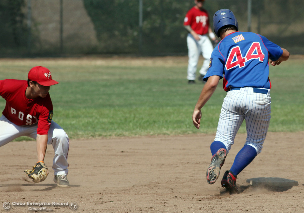 . Yolo Post 77\'s #4 Joseph Murray (left) attempts to field the ball to second base against Chico Nuts\' #44 Matt Gomes (right) in the bottom of the second inning during their American Legion baseball game at Doryland field Saturday, July 20, 2013 in Chico, Calif.  (Jason Halley/Chico Enterprise-Record)
