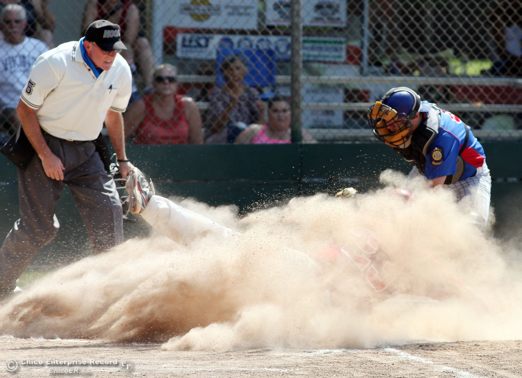 . Chico Nuts\' #9 Zach Visinoni (right) places the tag at home plate against Yolo Post 77\'s #23 Nicolas Sandoval (left) in the top of the second inning during their American Legion baseball game at Doryland field Saturday, July 20, 2013 in Chico, Calif. Sandoval was originally called safe by home plate umpire, but later reversed the call after talking to outfield umpire. The run did not count. (Jason Halley/Chico Enterprise-Record)
