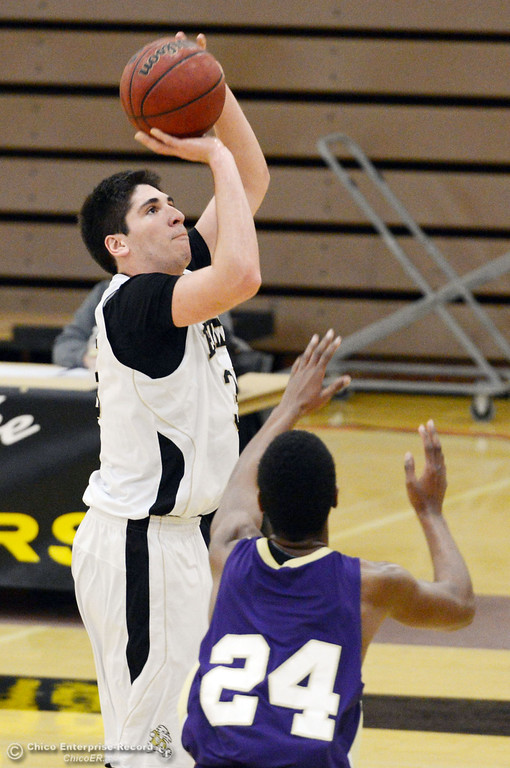 . Butte College\'s #35 Nikolas Petruk (left) takes a shot against San Jose City College\'s #24 Stevinaire Young (right) in the first half of their men\'s basketball game at Butte\'s Cowan Gym Friday, February 28, 2014 in Oroville, Calif.  (Jason Halley-Chico Enterprise-Record)