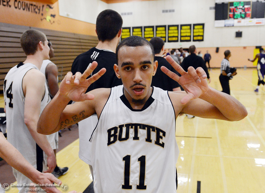 . Butte College\'s #11 Jamaal Davis (center) reacts to their win against San Jose City College at the end of the second half of their men\'s basketball game at Butte\'s Cowan Gym Friday, February 28, 2014 in Oroville, Calif.  (Jason Halley-Chico Enterprise-Record)