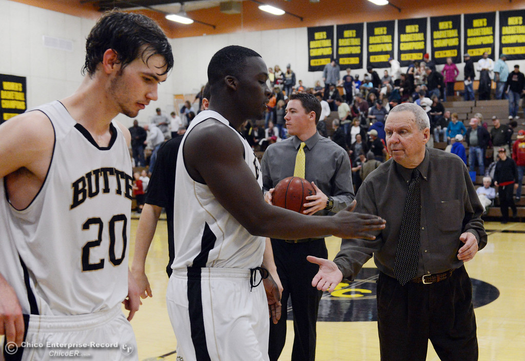 . Butte College\'s #20 Justin Gavard, #24 Michael Oloya and coach Russ Critchfield (left to right) celebrate their win against San Jose City College at the end of the second half of their men\'s basketball game at Butte\'s Cowan Gym Friday, February 28, 2014 in Oroville, Calif.  (Jason Halley-Chico Enterprise-Record)