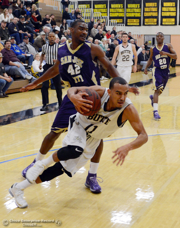 . Butte College\'s #11 Jamaal Davis (bottom) dribbles against San Jose City College\'s #42 Andre Russell (top) in the first half of their men\'s basketball game at Butte\'s Cowan Gym Friday, February 28, 2014 in Oroville, Calif.  (Jason Halley-Chico Enterprise-Record)