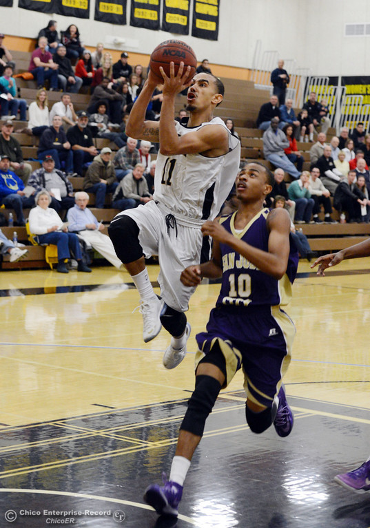 . Butte College\'s #11 Jamaal Davis (left) goes up for a shot against San Jose City College\'s #10 Bobby Gray (right) in the first half of their men\'s basketball game at Butte\'s Cowan Gym Friday, February 28, 2014 in Oroville, Calif.  (Jason Halley-Chico Enterprise-Record)