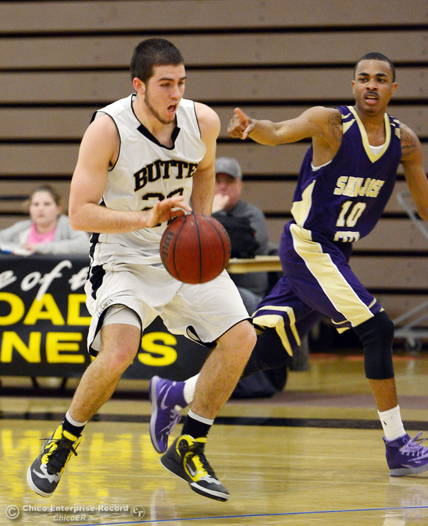 . Butte College\'s #22 Jud Sailsbery (left) dribbles against San Jose City College\'s #10 Bobby Gray (right) in the first half of their men\'s basketball game at Butte\'s Cowan Gym Friday, February 28, 2014 in Oroville, Calif.  (Jason Halley-Chico Enterprise-Record)
