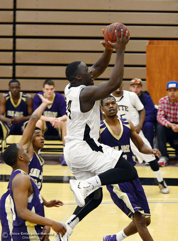 . Butte College\'s #24 Michael Oloya (center) goes up for a shot against San Jose City College in the first half of their men\'s basketball game at Butte\'s Cowan Gym Friday, February 28, 2014 in Oroville, Calif.  (Jason Halley-Chico Enterprise-Record)