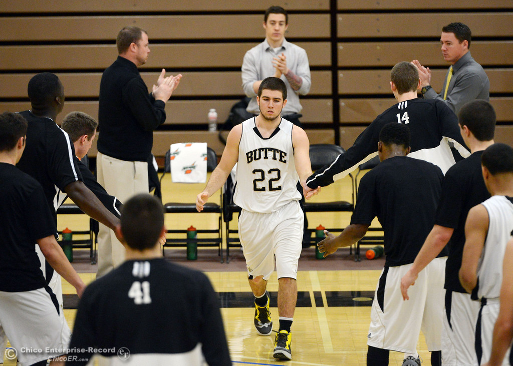 . Butte College\'s #22 Jud Sailsbery (center) is introduced against San Jose City College before the first half of their men\'s basketball game at Butte\'s Cowan Gym Friday, February 28, 2014 in Oroville, Calif.  (Jason Halley-Chico Enterprise-Record)