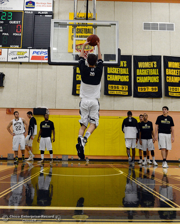 . Butte College #29 Justin Gavard (center) warms up against San Jose City College before the first half of their men\'s basketball game at Butte\'s Cowan Gym Friday, February 28, 2014 in Oroville, Calif.  (Jason Halley-Chico Enterprise-Record)
