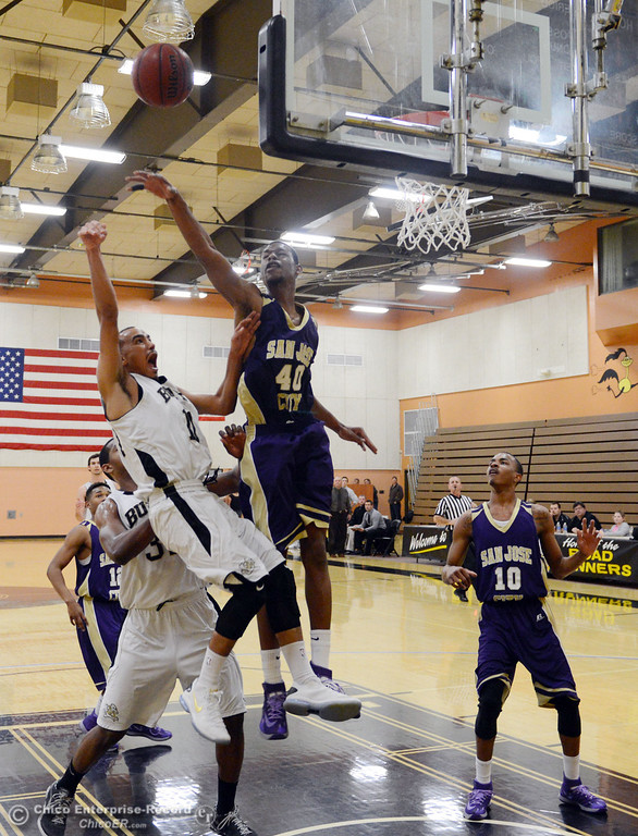 . Butte College\'s #11 Jamaal Davis (left) goes up for a shot against San Jose City College\'s #40 Maurice Joiner (right) in the first half of their men\'s basketball game at Butte\'s Cowan Gym Friday, February 28, 2014 in Oroville, Calif.  (Jason Halley-Chico Enterprise-Record)