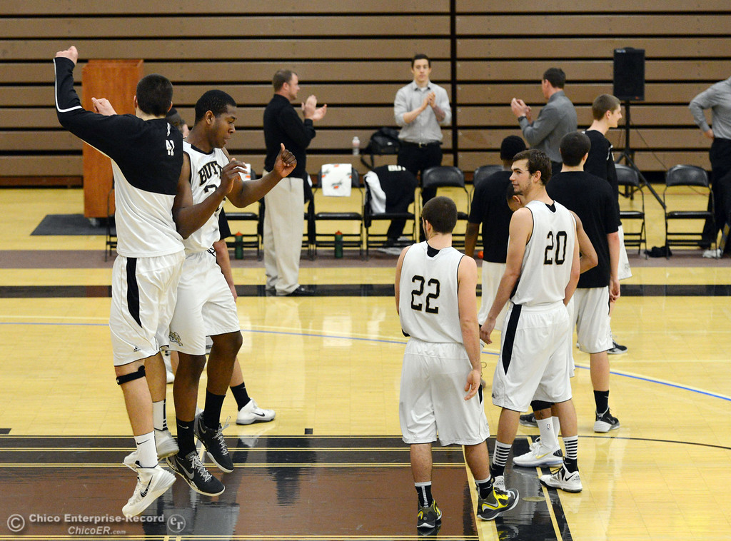 . Butte College\'s #41 Connor Morningstar (left) leaps up to greet #32 Arthur Caldwell (center) who is introduced against San Jose City College before the first half of their men\'s basketball game at Butte\'s Cowan Gym Friday, February 28, 2014 in Oroville, Calif.  (Jason Halley-Chico Enterprise-Record)