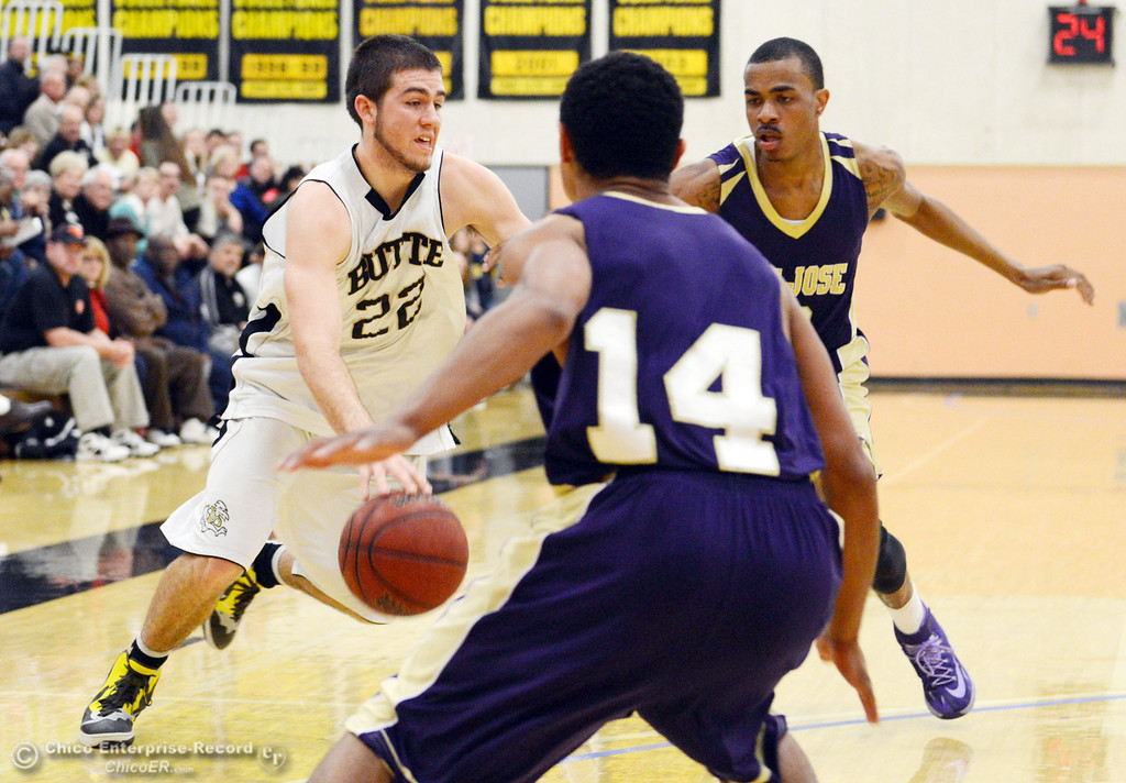 . Butte College\'s #22 Jud Sailsbery (left) dribbles against San Jose City College\'s #10 Bobby Gray (right) and #14 Anthoni Rueca (front) in the first half of their men\'s basketball game at Butte\'s Cowan Gym Friday, February 28, 2014 in Oroville, Calif.  (Jason Halley-Chico Enterprise-Record)