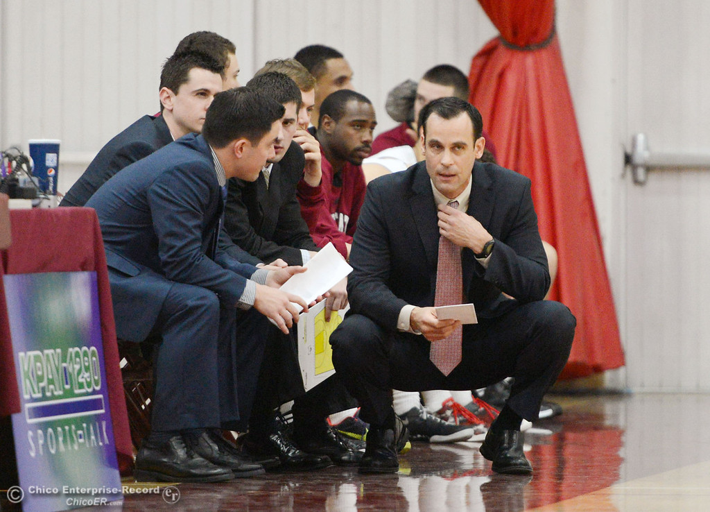 . Chico State head coach Greg Clink (right) talks to the coaches on the sideline against Cal State Dominguez Hills in the first half of their men\'s basketball game at CSUC Acker Gym Friday, January 10, 2014 in Chico, Calif.  (Jason Halley/Chico Enterprise-Record)