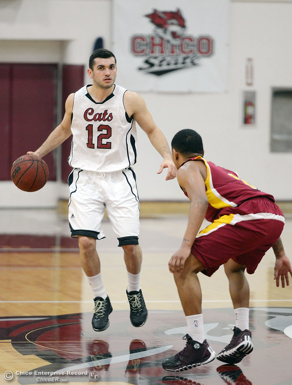 . Chico State\'s #12 Giordano Estrada (left) dribbles against Cal State Dominguez Hills\' #1 Chris Carvin (right) in the first half of their men\'s basketball game at CSUC Acker Gym Friday, January 10, 2014 in Chico, Calif.  (Jason Halley/Chico Enterprise-Record)