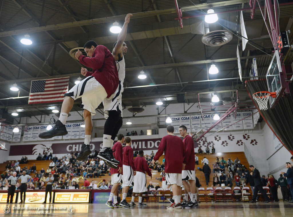 . Chico State\'s #45 Jordan Semple (left) and #41 Jordan Barton (right) leap in the air to ready against Cal State Dominguez Hills in the first half of their men\'s basketball game at CSUC Acker Gym Friday, January 10, 2014 in Chico, Calif.  (Jason Halley/Chico Enterprise-Record)