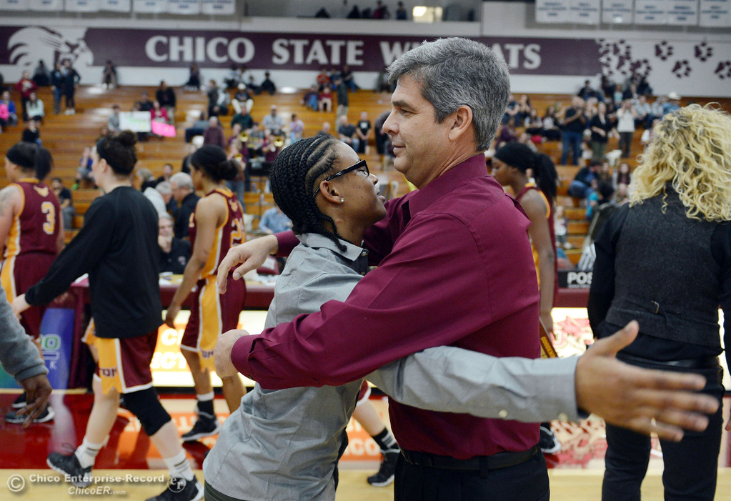 . Former Chico State player and current Cal State Dominguez Hills\' assistant coach Natasha Smith (left) hugs Chico State head coach Brian Fogel (right) after their women\'s basketball game at CSUC Acker Gym Friday, January 10, 2014 in Chico, Calif.  (Jason Halley/Chico Enterprise-Record)