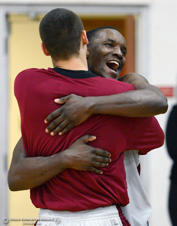 . Chico State\'s Rashad Parker (back) is embraced by Robert Duncan after winning against Cal State San Bernardino at the end of the second half of their men\'s basketball game at CSUC Acker Gym Saturday, February 8, 2014 in Chico, Calif.  (Jason Halley/Chico Enterprise-Record)