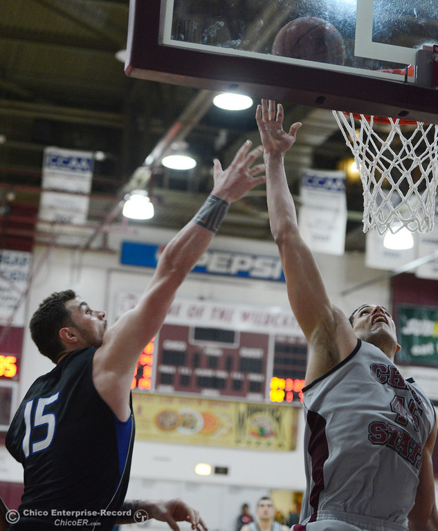 . Chico State\'s #45 Jordan Semple (right) goes up for a shot against Cal State San Bernardino\'s #15 Andrew Young (left) in the second half of their men\'s basketball game at CSUC Acker Gym Saturday, February 8, 2014 in Chico, Calif.  (Jason Halley/Chico Enterprise-Record)