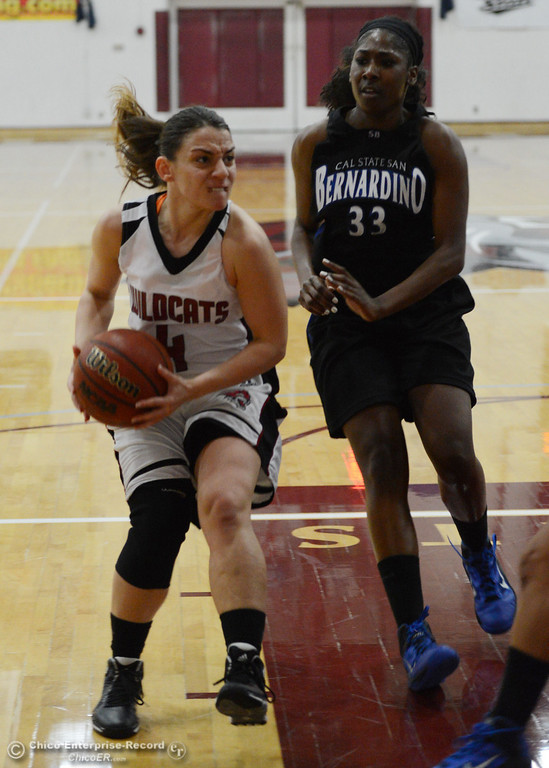 . Chico State\'s #4 Sarah Rebibo (left) goes up for a shot against Cal State San Bernardino\'s #33 Trinidee Trice (right) in the first half of their women\'s basketball game at CSUC Acker Gym Saturday, February 8, 2014 in Chico, Calif.  (Jason Halley/Chico Enterprise-Record)