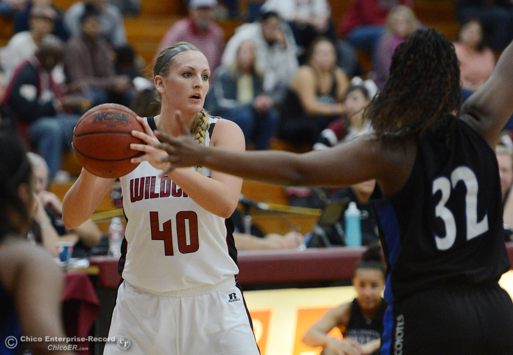 . Chico State\'s #40 Analise Riezebos (left) looks to pass against Cal State San Bernardino\'s #32 Jazzmyn Davis (right) in the first half of their women\'s basketball game at CSUC Acker Gym Saturday, February 8, 2014 in Chico, Calif.  (Jason Halley/Chico Enterprise-Record)