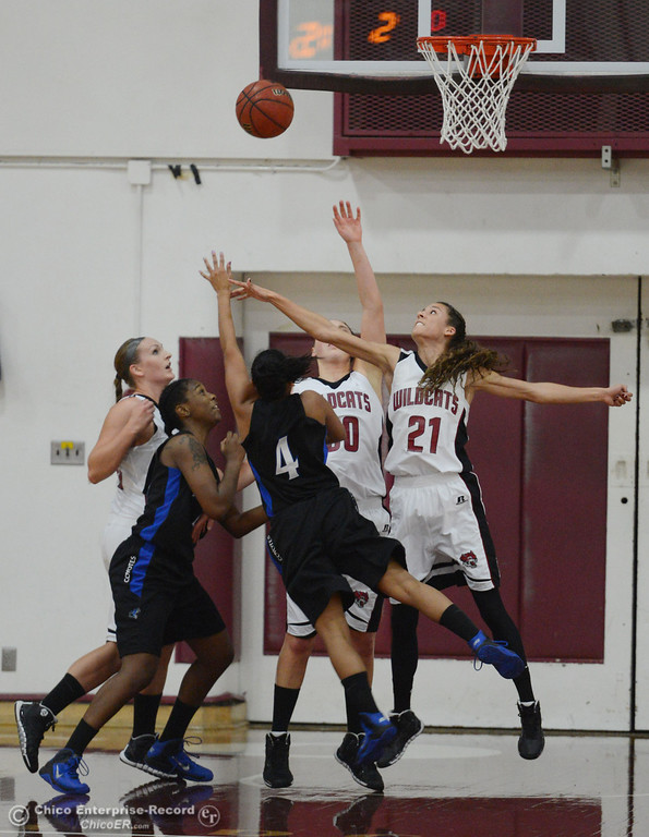 . Chico State\'s #30 McKenzie Dalthorp (back) and #21 Courtney Hamilton (right) attempt to block against Cal State San Bernardino\'s #4 Alexcia Mack (left) in the first half of their women\'s basketball game at CSUC Acker Gym Saturday, February 8, 2014 in Chico, Calif.  (Jason Halley/Chico Enterprise-Record)