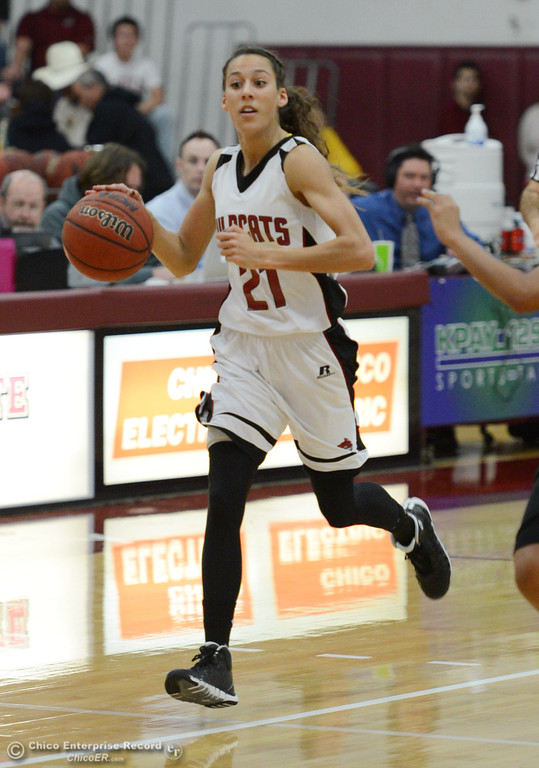 . Chico State\'s #21 Courtney Hamilton (left) dribbles against Cal State San Bernardino\'s #4 Alexcia Mack (right) in the first half of their women\'s basketball game at CSUC Acker Gym Saturday, February 8, 2014 in Chico, Calif.  (Jason Halley/Chico Enterprise-Record)