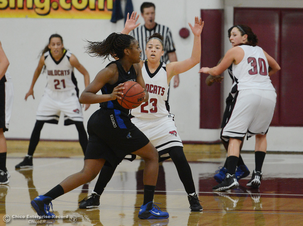 . Chico State\'s #23 Jazmine Miller (right) defends against Cal State San Bernardino\'s #32 Jazzmyn Davis (left) in the first half of their women\'s basketball game at CSUC Acker Gym Saturday, February 8, 2014 in Chico, Calif.  (Jason Halley/Chico Enterprise-Record)
