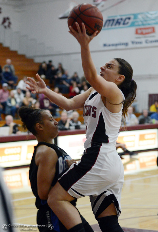 . Chico State\'s #4 Sarah Rebibo (right) goes up for a shot against Cal State San Bernardino\'s #15 Tatiana Dunlap (left) in the first half of their women\'s basketball game at CSUC Acker Gym Saturday, February 8, 2014 in Chico, Calif.  (Jason Halley/Chico Enterprise-Record)