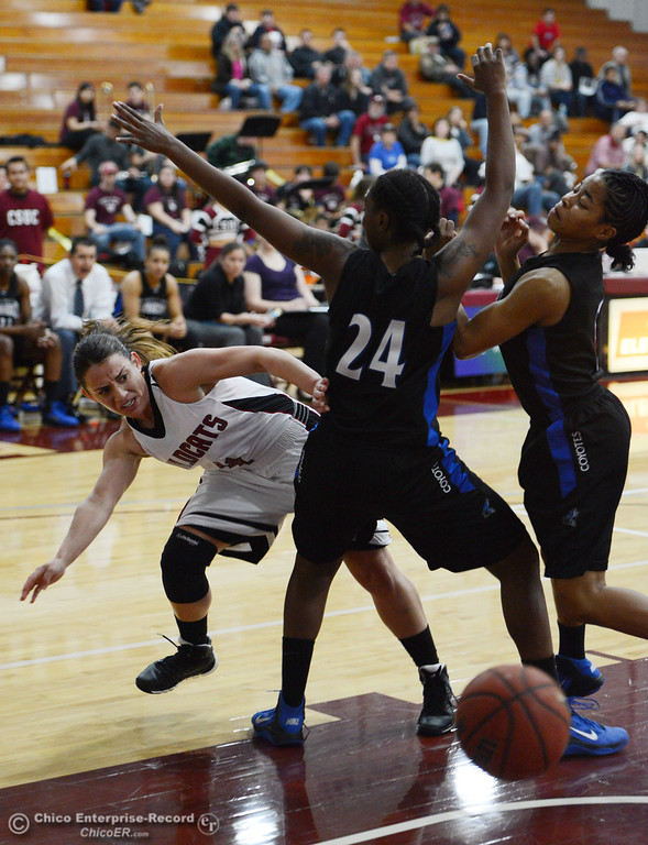 . Chico State\'s #4 Sarah Rebibo (left) passes against Cal State San Bernardino\'s #24 Adriana Brodie (right) in the first half of their women\'s basketball game at CSUC Acker Gym Saturday, February 8, 2014 in Chico, Calif.  (Jason Halley/Chico Enterprise-Record)