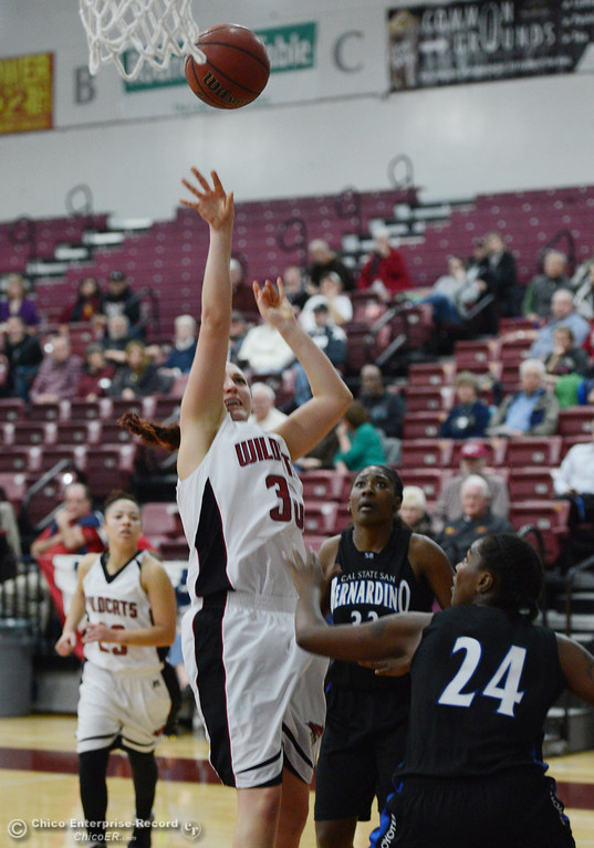 . Chico State\'s #30 McKenzie Dalthorp (left) takes a shot against Cal State San Bernardino\'s #24 Adriana Brodie (right) in the first half of their women\'s basketball game at CSUC Acker Gym Saturday, February 8, 2014 in Chico, Calif.  (Jason Halley/Chico Enterprise-Record)