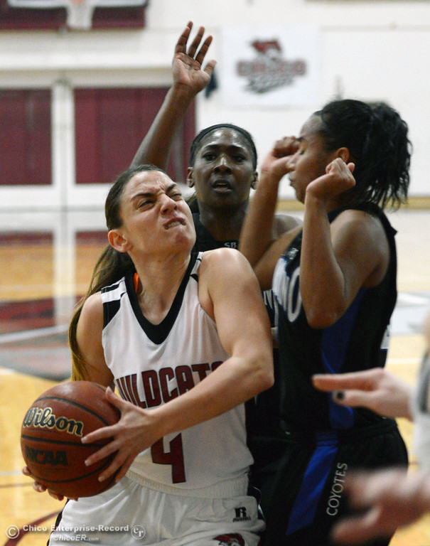 . Chico State\'s #4 Sarah Rebibo (left) goes up for a shot against Cal State San Bernardino\'s #4 Alexcia Mack (right) and #33 Trinidee Trice (back) in the first half of their women\'s basketball game at CSUC Acker Gym Saturday, February 8, 2014 in Chico, Calif.  (Jason Halley/Chico Enterprise-Record)