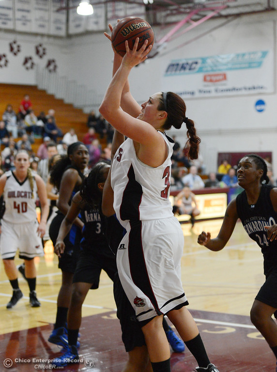 . Chico State\'s #30 McKenzie Dalthorp goes up for a shot against Cal State San Bernardino in the first half of their women\'s basketball game at CSUC Acker Gym Saturday, February 8, 2014 in Chico, Calif.  (Jason Halley/Chico Enterprise-Record)