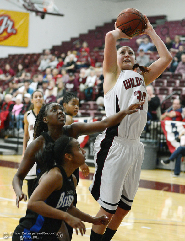 . Chico State\'s #30 McKenzie Dalthorp (right) takes a shot against Cal State San Bernardino\'s #32 Jazzmyn Davis (center) and #4 Alexcia Mack (bottom) in the first half of their women\'s basketball game at CSUC Acker Gym Saturday, February 8, 2014 in Chico, Calif.  (Jason Halley/Chico Enterprise-Record)
