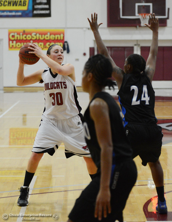 . Chico State\'s #30 McKenzie Dalthorp (left) looks to pass against Cal State San Bernardino\'s #24 Adriana Brodie (right) in the first half of their women\'s basketball game at CSUC Acker Gym Saturday, February 8, 2014 in Chico, Calif.  (Jason Halley/Chico Enterprise-Record)
