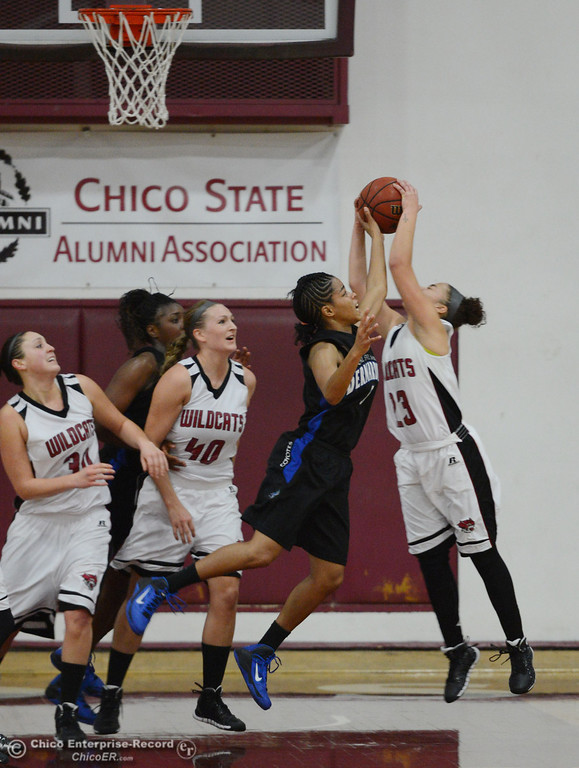 . Chico State\'s #23 Jazmine Miller right) rebounds against Cal State San Bernardino\'s #5 Tayllor Gipson (left) in the second half of their women\'s basketball game at CSUC Acker Gym Saturday, February 8, 2014 in Chico, Calif.  (Jason Halley/Chico Enterprise-Record)