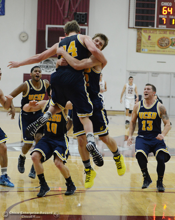 . UC San Diego\'s #14 Drew Dyer (center) is celebrating on scoring the final shot before the buzzer to win with #12 Adam Klie (right) and others against Chico State\'s at the end of the second half of their men\'s basketball game at CSUC Acker Gym Friday, February 7, 2014 in Chico, Calif.  (Jason Halley/Chico Enterprise-Record)
