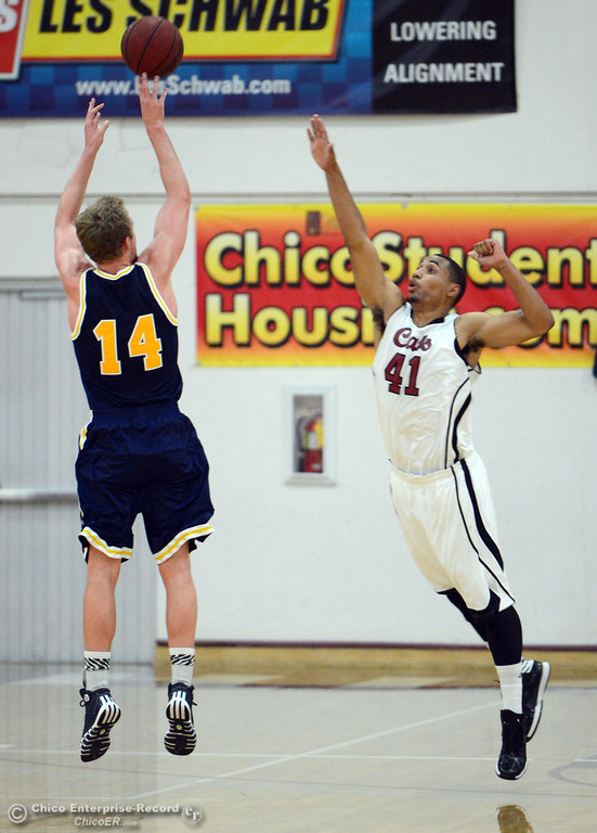 . Chico State\'s #41 Jordan Barton (right) attempts to block against UC San Diego\'s #14 Drew Dyer (left) in the first half of their men\'s basketball game at CSUC Acker Gym Friday, February 7, 2014 in Chico, Calif.  (Jason Halley/Chico Enterprise-Record)