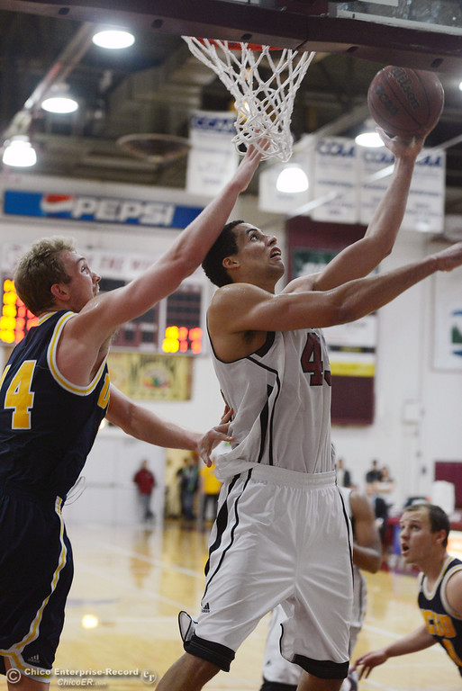 . Chico State\'s #45 Jordan Semple (right) goes up for a shot against UC San Diego\'s #14 Drew Dyer (left) in the second half of their men\'s basketball game at CSUC Acker Gym Friday, February 7, 2014 in Chico, Calif.  (Jason Halley/Chico Enterprise-Record)