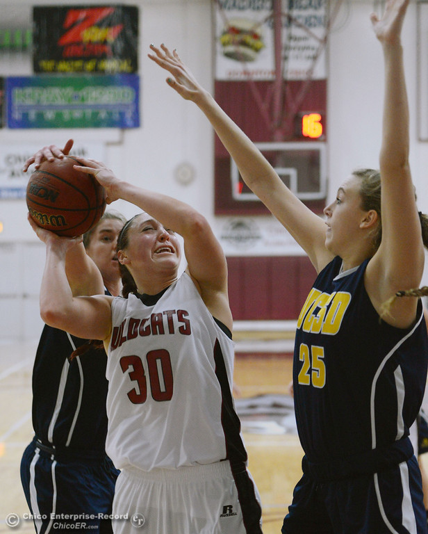 . Chico State\'s #30 McKenzie Dalthorp (center) goes up for a shot against UC San Diego\'s #34 Erin Dautremont (back) and #25 Taylor Hirz (right) in the second half of their women\'s basketball game at CSUC Acker Gym Friday, February 7, 2014 in Chico, Calif.  (Jason Halley/Chico Enterprise-Record)