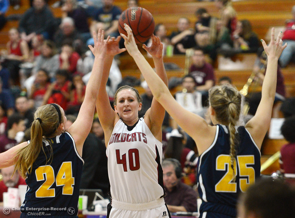 . Chico State\'s #40 Analise Riezebos (center) looks against UC San Diego\'s #24 Haley Anderson (left) and #25 Taylor Hirz (right) in the second half of their women\'s basketball game at CSUC Acker Gym Friday, February 7, 2014 in Chico, Calif.  (Jason Halley/Chico Enterprise-Record)