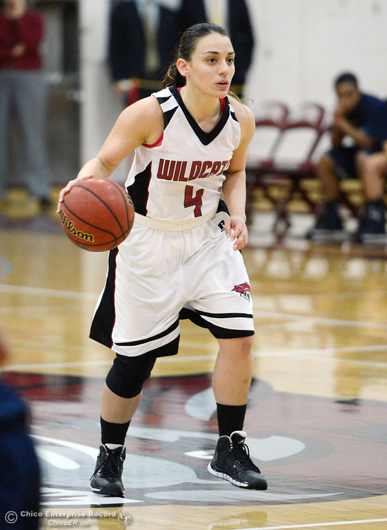 . Chico State\'s #4 Sarah Rebibo dribbles against UC San Diego in the second half of their women\'s basketball game at CSUC Acker Gym Friday, February 7, 2014 in Chico, Calif.  (Jason Halley/Chico Enterprise-Record)