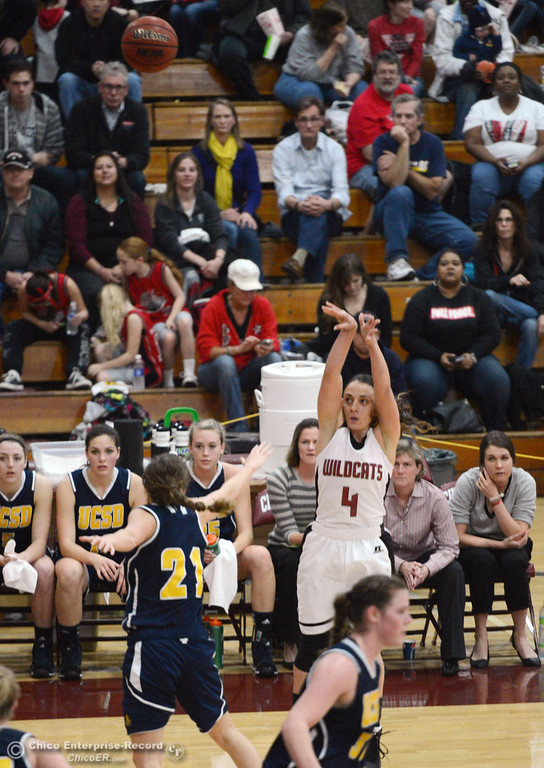 . Chico State\'s #4 Sarah Rebibo (right) takes a shot against UC San Diego\'s #21 Megan Perry (left) in the first half of their women\'s basketball game at CSUC Acker Gym Friday, February 7, 2014 in Chico, Calif.  (Jason Halley/Chico Enterprise-Record)