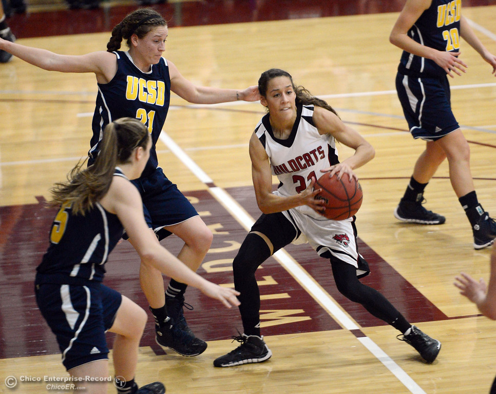. Chico State\'s #21 Courtney Hamilton (right) passes against UC San Diego\'s #21 Megan Perry (center) and #5 Cassie MacLeod (left) in the first half of their women\'s basketball game at CSUC Acker Gym Friday, February 7, 2014 in Chico, Calif.  (Jason Halley/Chico Enterprise-Record)